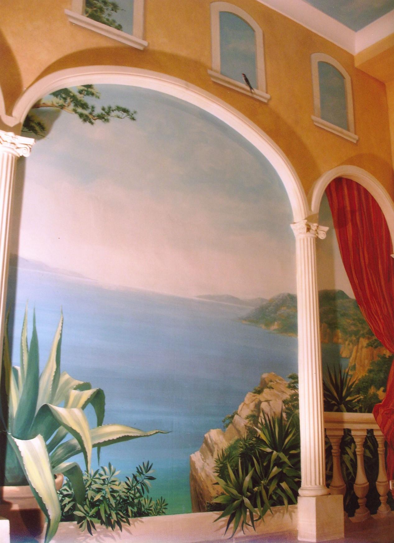 Ein Ausblick über eine Bucht verschafft die perfekte Illusion einer mediterranen Szenerie. Wandgestaltung und  Illusionmalerei aus Berlin vom Atelier-Witzmann.